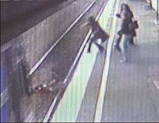 Baby in stroller being hit by the train while mom in desperation tries to save her child